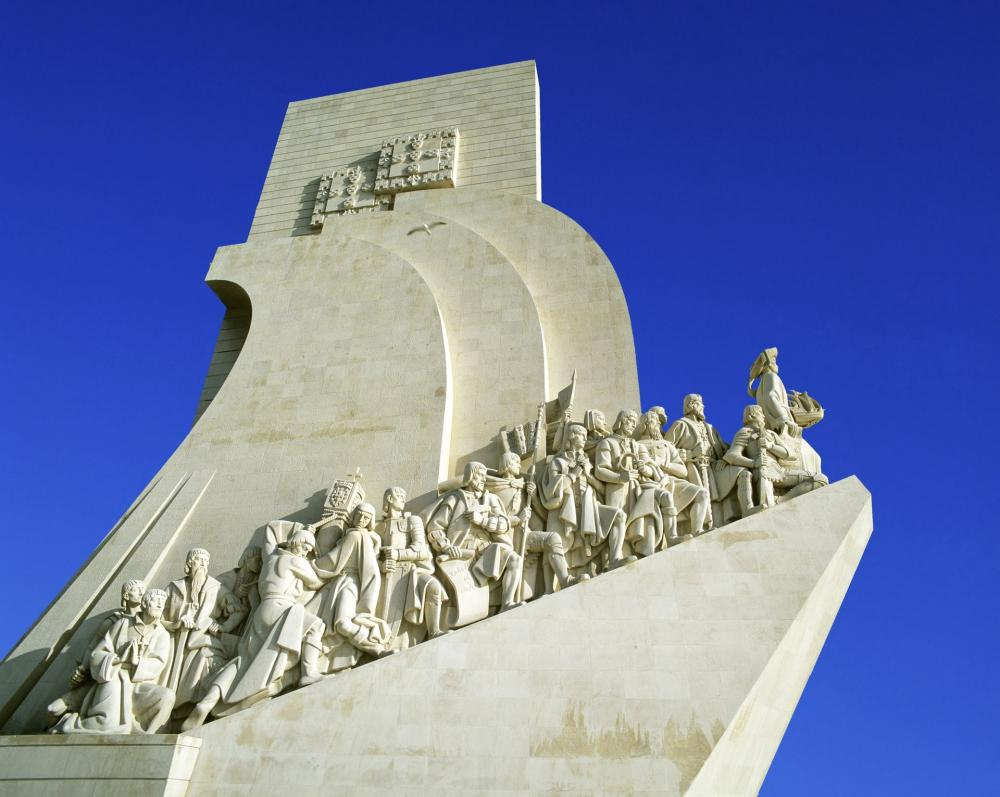Monument of the Discoveries or  Padrão dos Descobrimentos  , seen on the banks of the Tagus River from the west.