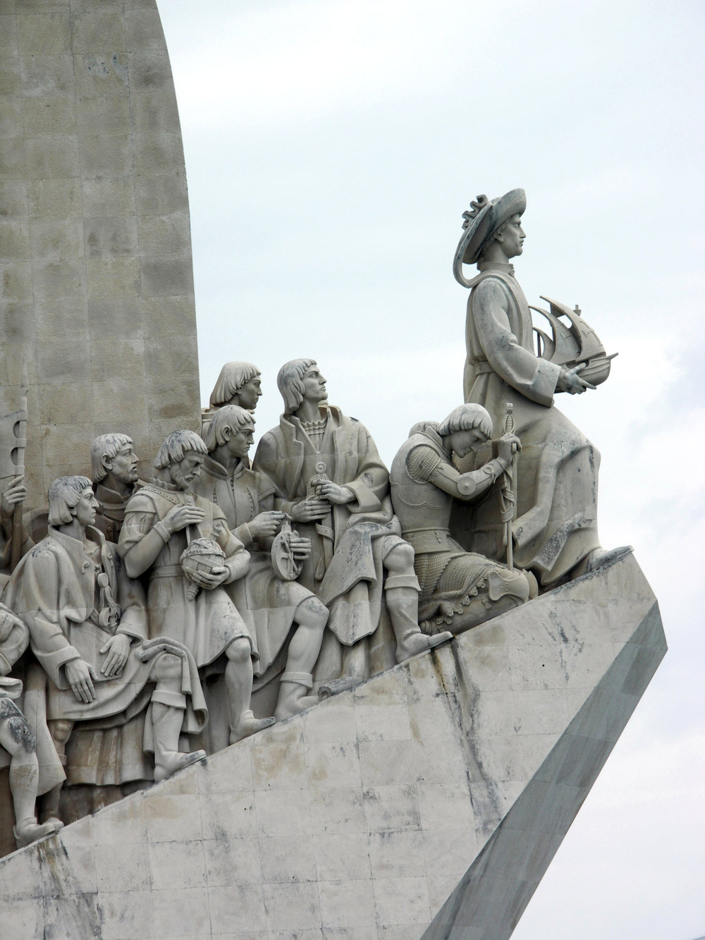 Detail of some of the 33 figures depicted amongst the leaders in the Age of Discovery, with Henry the Navigator holding a carrack at the top of the ramp, Monument of the Discoveries, Lisbon