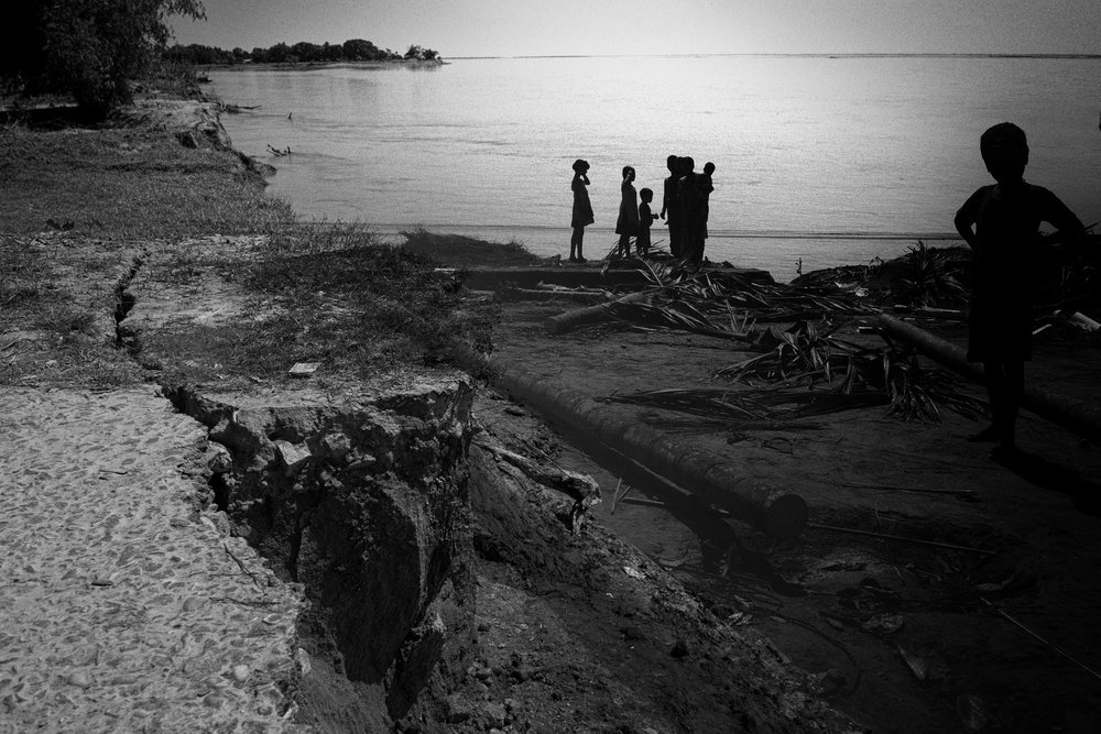 A composite of eroded land, gulped by the river, and a family that has lost its homestead in the same area. This is in Upper Assam
