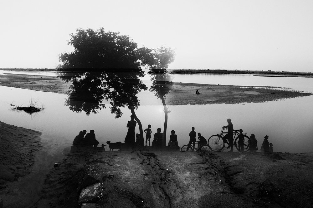 The politics of thirst rules the relationship between India and Bangladesh. 54 of 57 rivers that flow in Bangladesh flow from India. India plays god, controlling the water flow. This is the Teesta in Bangladesh, layered with the people who live on its banks and who are severely affected by the lack of water in the river for eight months of the year.