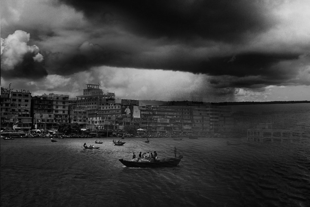 The Sundarbans is the first line of defense for the city of Khulna (Bangladesh) in the battle against raging storm surges and climate change. This is a composite of the protector and the protected, both now under threat, if the Sundarbans should be destroyed.