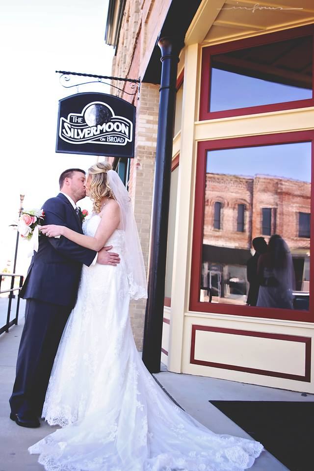 Landreth Kiss Under Sign.jpg