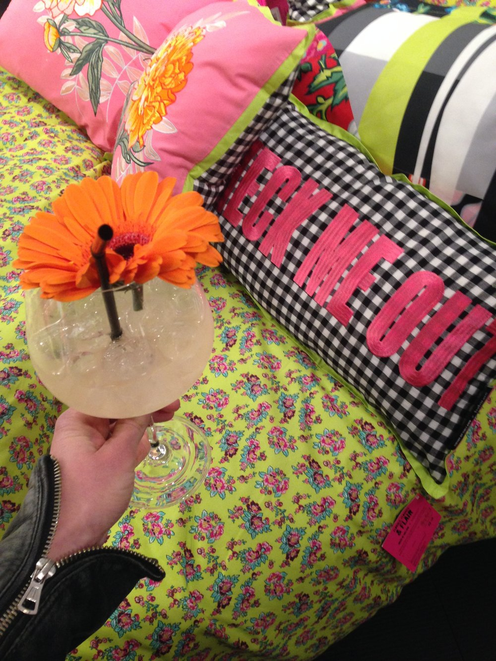 The House of Holland x Habitat bedding and gingham slogan cushion accessorised here with novelty cocktail.