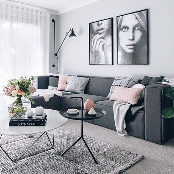 - The black wall lamp and Hay DLM side table give this classic grey and pink Scandi setting the required va va voom.