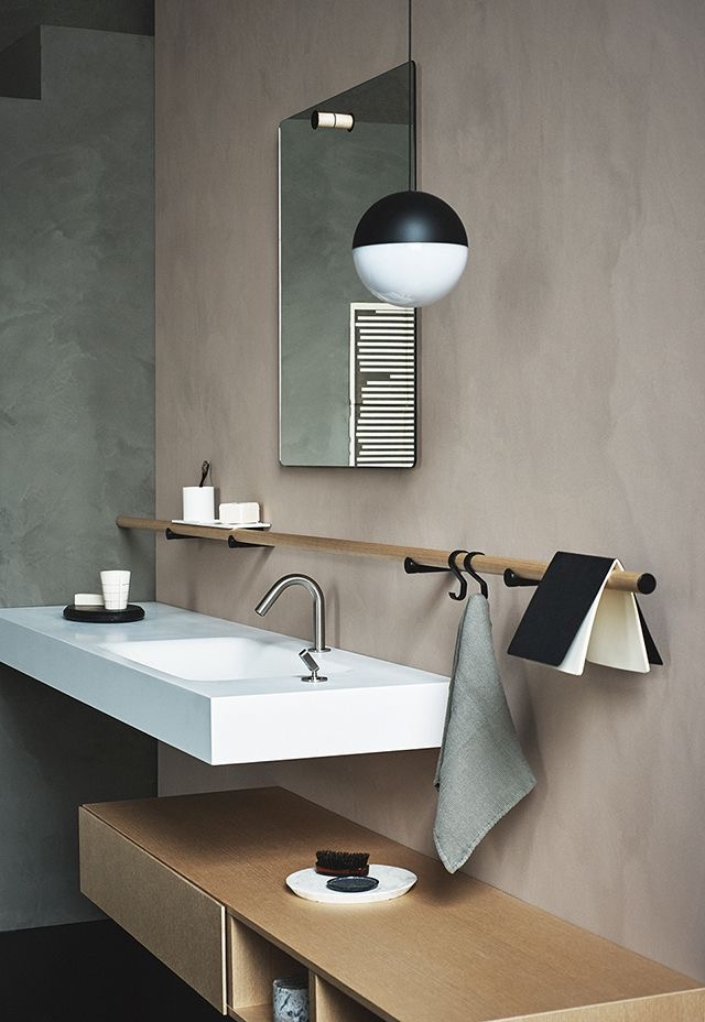 - I honestly don't think I'd look twice at this scheme if it wasn't for the Flos pendant light and the shelf brackets. But the matt black against the rough luxe texture of the freshly plastered wall gives it a major wow factor. Black notebook optional.Image via Garcia Cumini