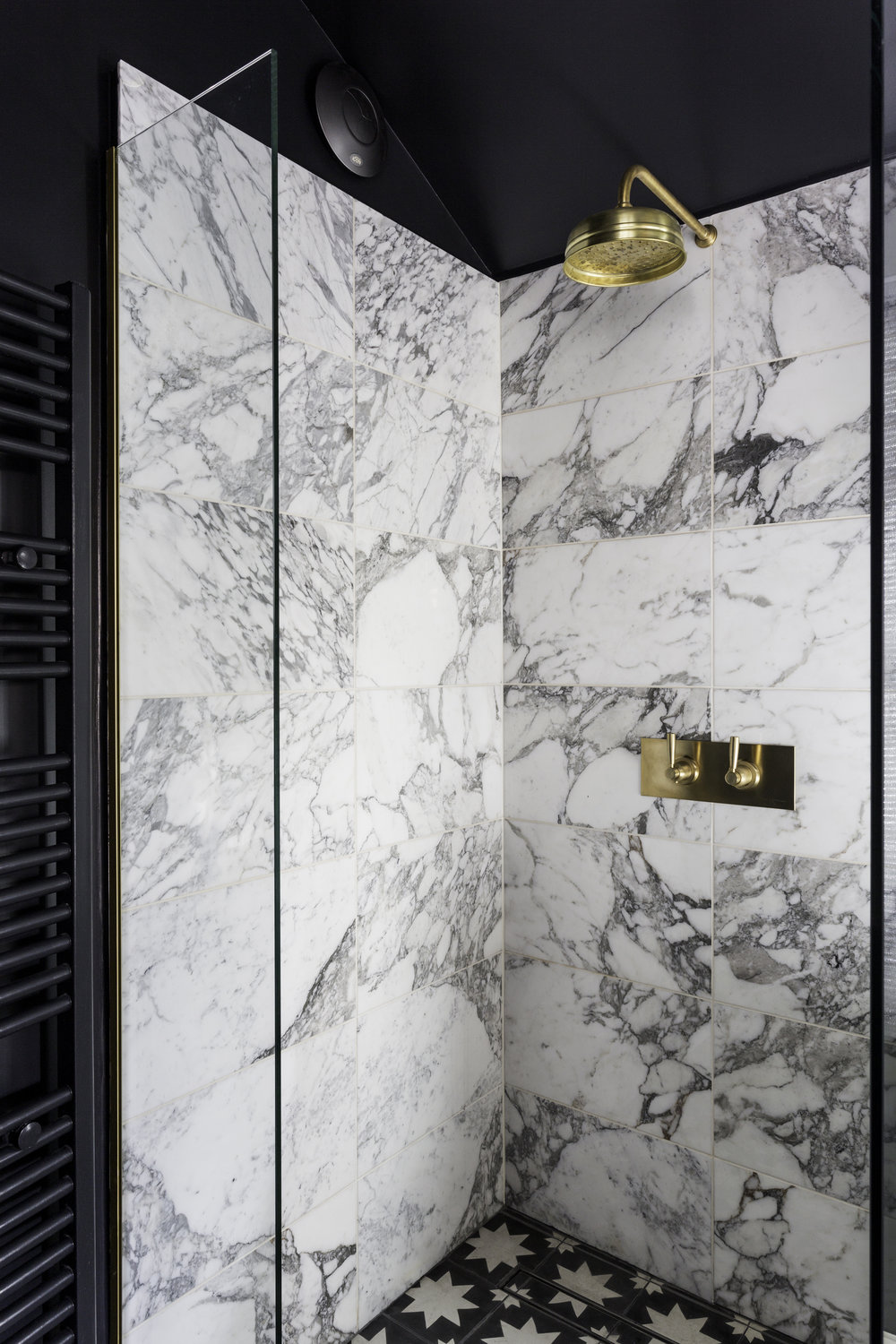 I know I'm biased but this is the best shower I have ever had. Shower mixer with levers and shower head from Perrin & Rowe, Arabescato marble wall tiles from Topps Tiles , floor tiles from Bert & May. Photo: Kasia Fiszer
