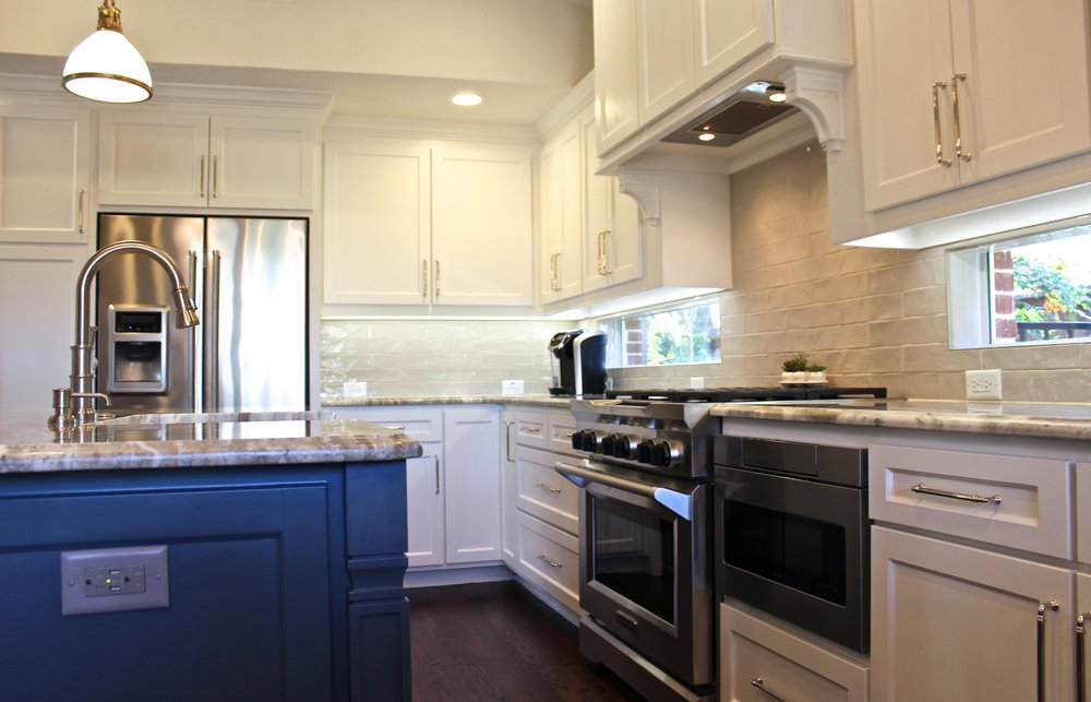 After: Light and bright with state-of-the-art stainless steel KitchenAid appliances