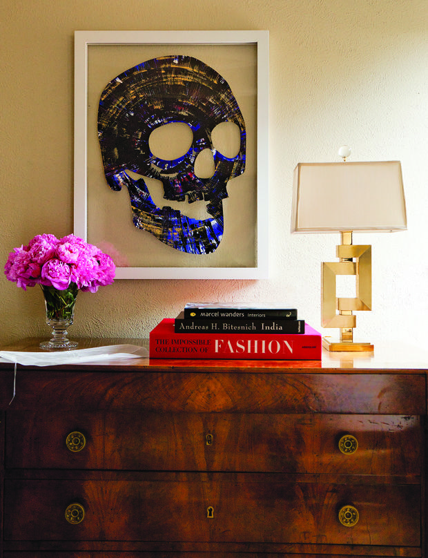 Modern brass lamp displayed on an antique chest of drawers. I love the juxtaposition of styling with old and new pieces.