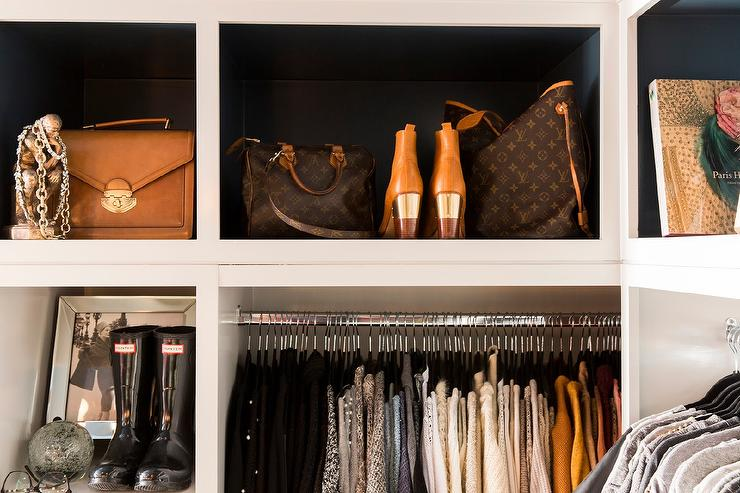 Louis Vuitton bags displayed beautifully in a very lucky woman's closet <3