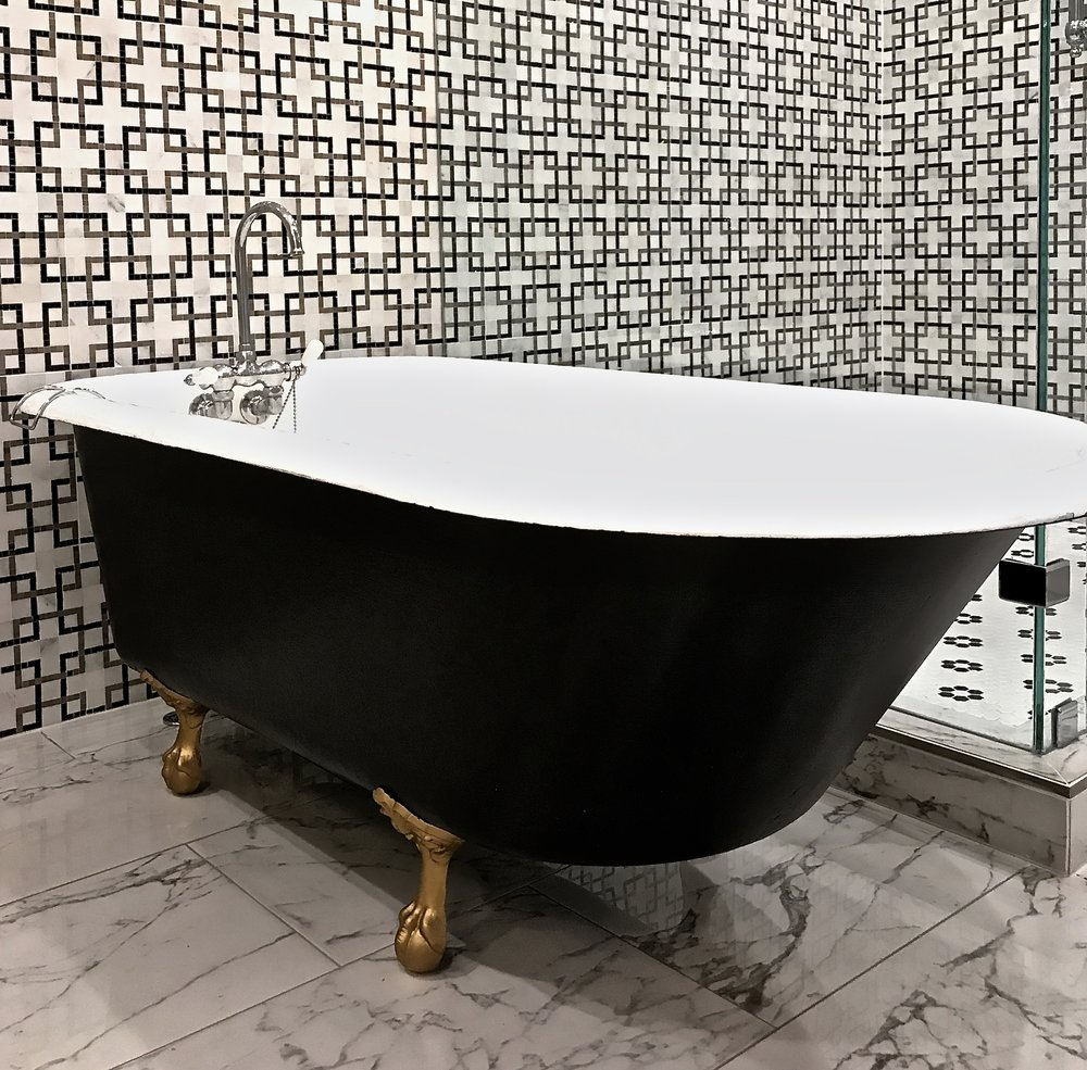 Refinished claw foot bath tub- an updated original.