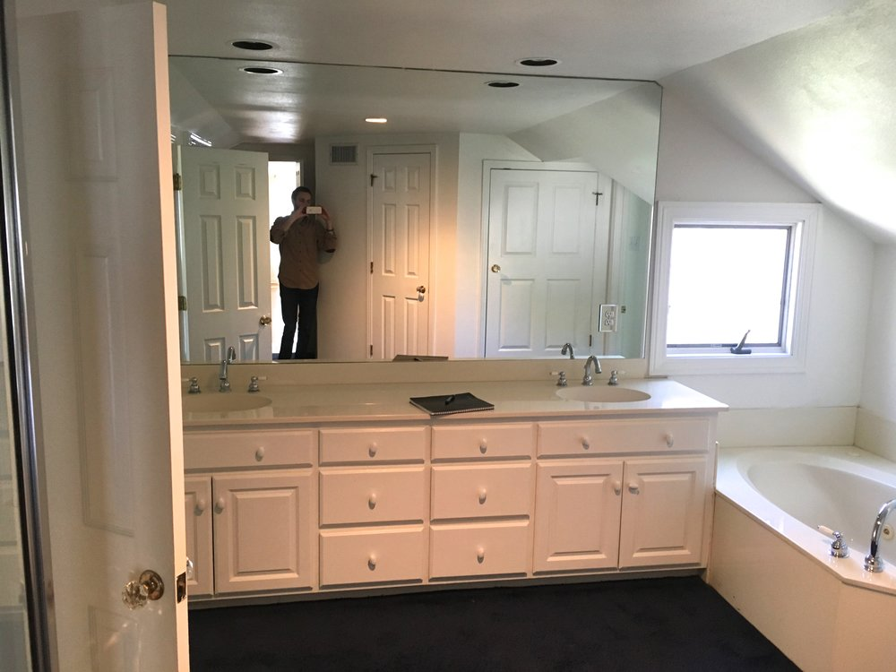 Before: The bath tub and shower were in separate locations, and the space was divided. Also, notice the navy blue carpet. Yikes!