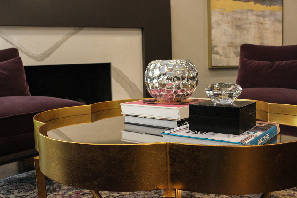 The gold leaf finished coffee table adds a unique feature to the space.