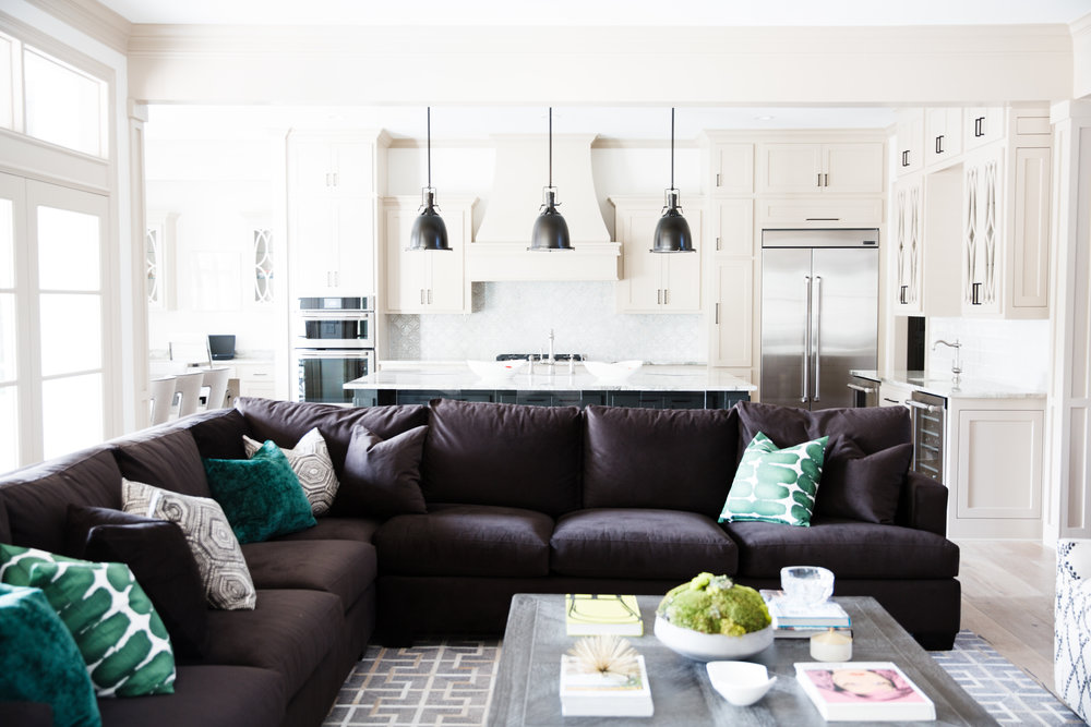 Design tip: You don't have to use walls to define spaces. This grand sectional divides the kitchen from the living rom, while allowing the space to remain open and bright. Light filters through every inch of the space.