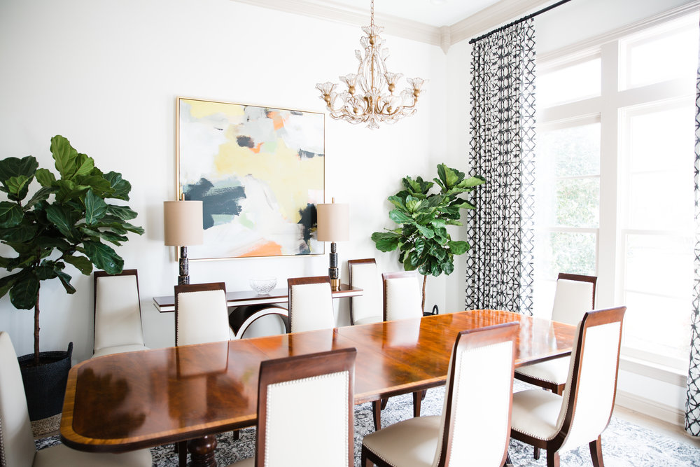 The dining table is a family heirloom. It was the only piece of furniture that we kept after the remodel. I sourced these leather trimmed dining chairs to replace the old ones. The custom window treatments are mounted just below the crown molding to draw the eye upwards, and create a dramatic effect.