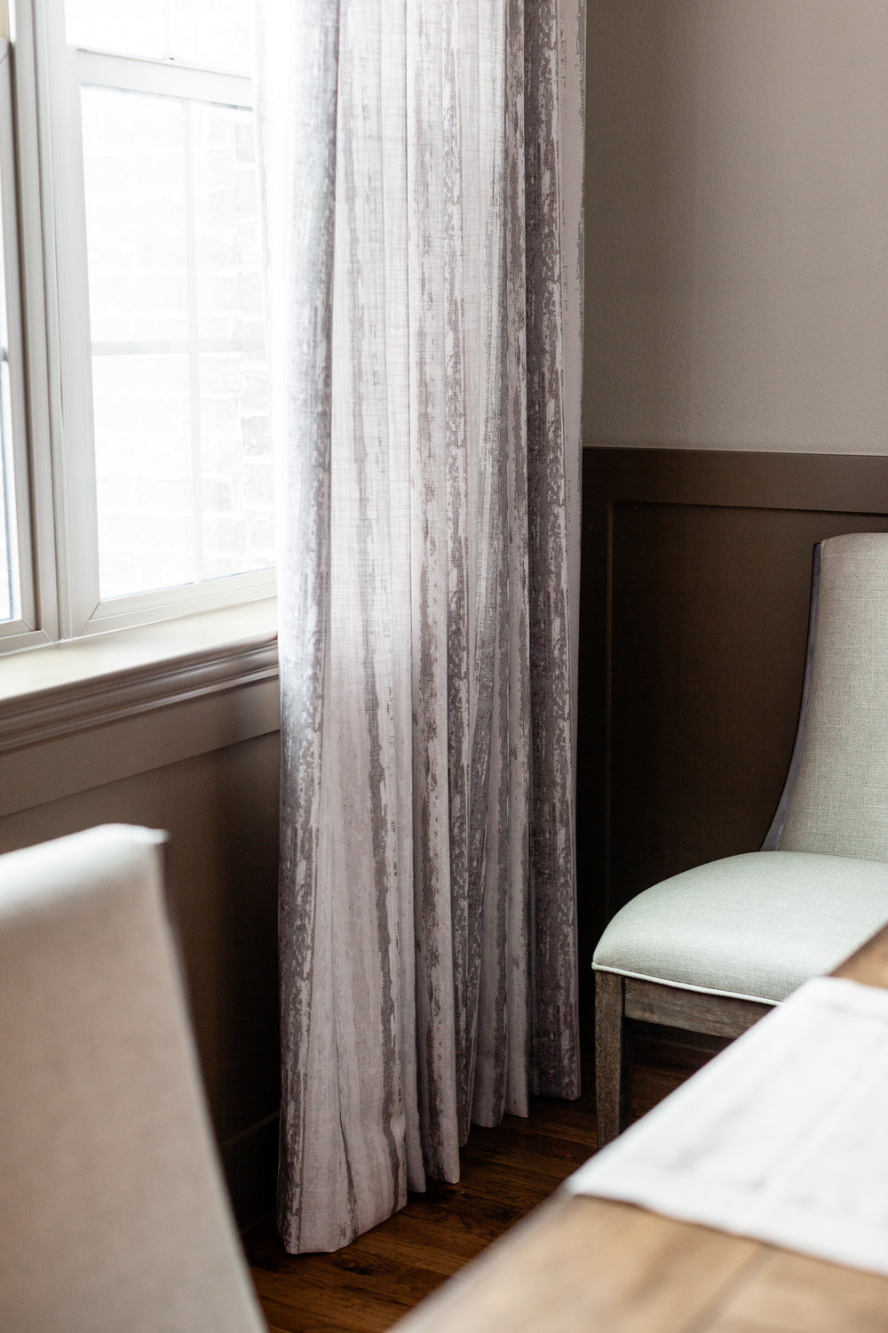 Custom window treatments combine both the millwork and wall colors.
