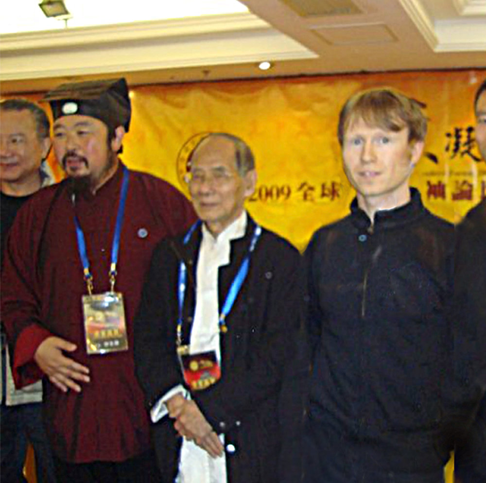 Niel representing the UK the Global martial arts leaders conference in Macau, China 2009 - From left to right.  Grandmaster You Xuande the Abbot of the Wudang Taoist Tai Chi,   Great GrandmasterWong Gong keeper of Jiangmen branch of Choy Li Fut and Lohan Qigong and Grandmaster Niel Willcott Lohan Martial Arts.