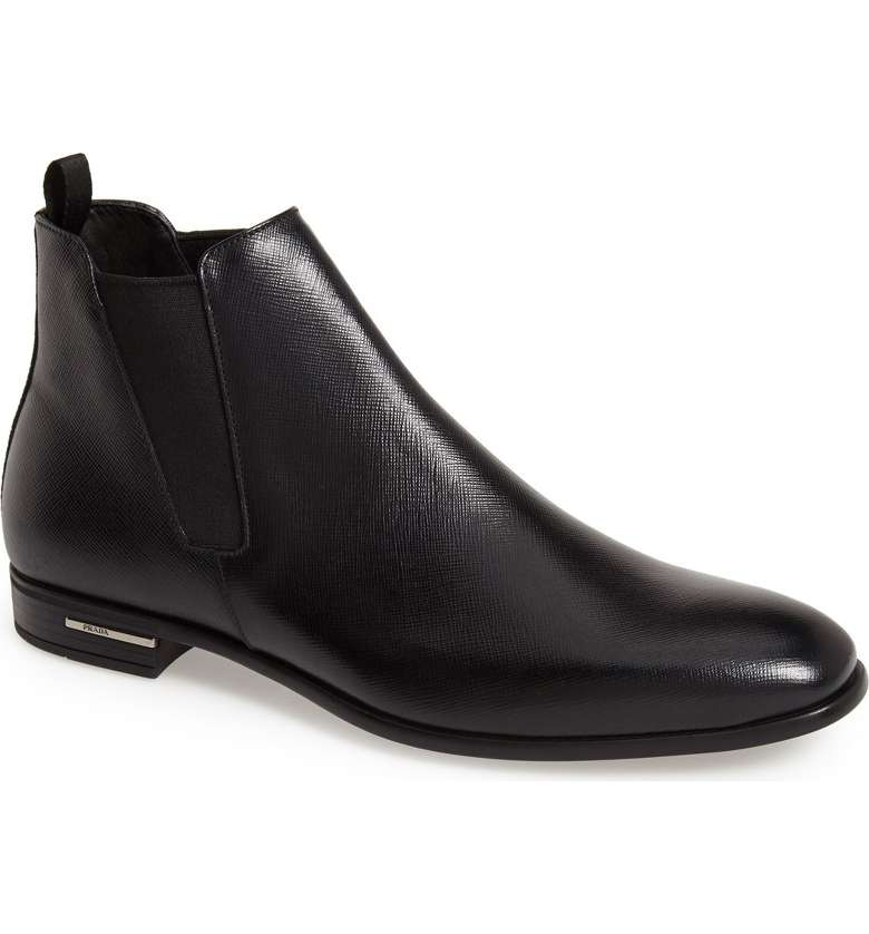 THE BOOT - The Prada Saffiano Chelsea Boot has class to spare. Fine leather, sleek lines, and classic cool.