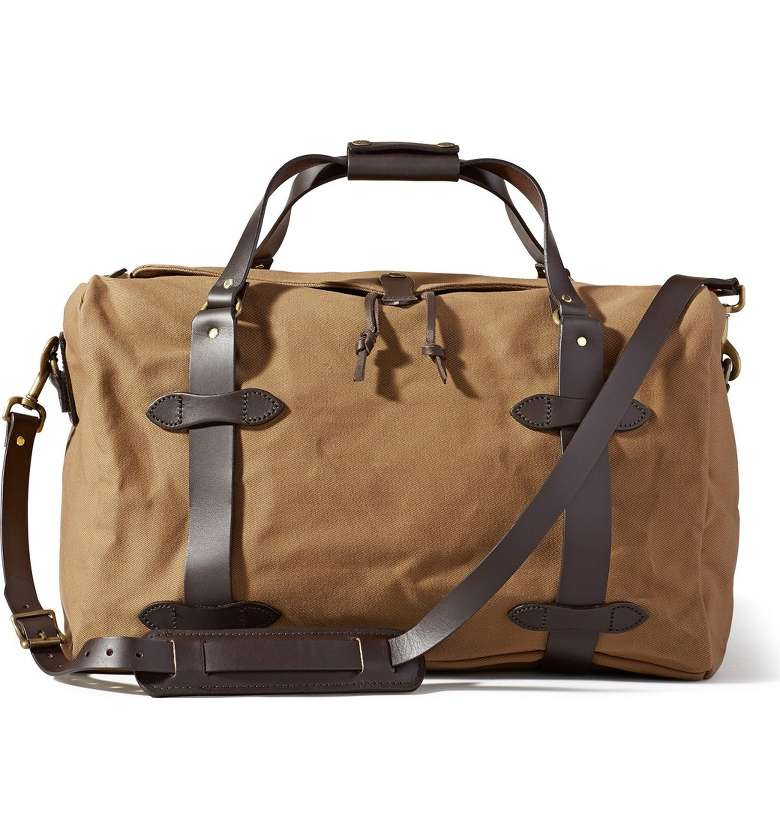CARRY - The Filson Medium Duffel Bag is rough & ready for adventures on the open road, the high seas, & wide open spaces. Our go-to for getting away from it all.