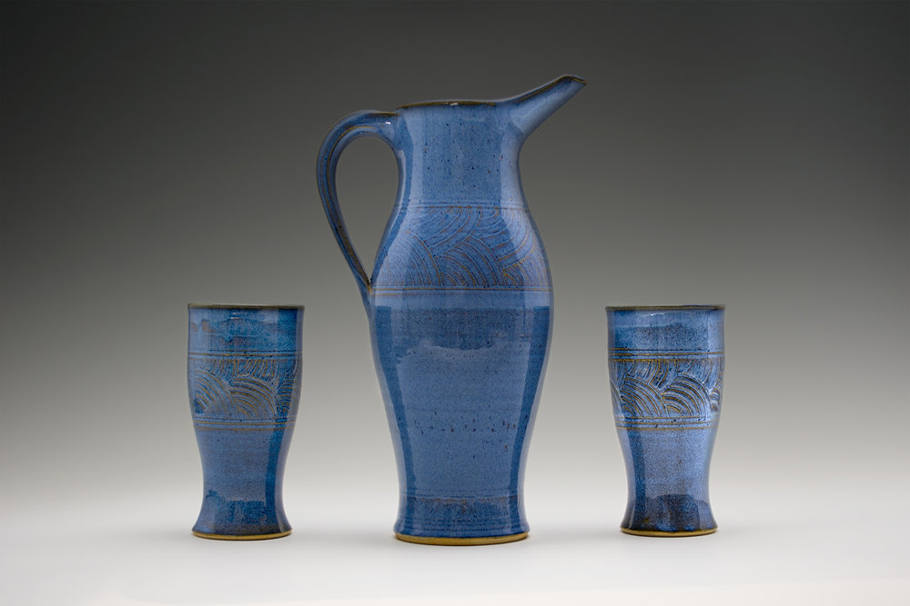 Basket-weave Pitcher and Tumbler Set. Pattern is hand carved on each piece to create a visual and physical texture.