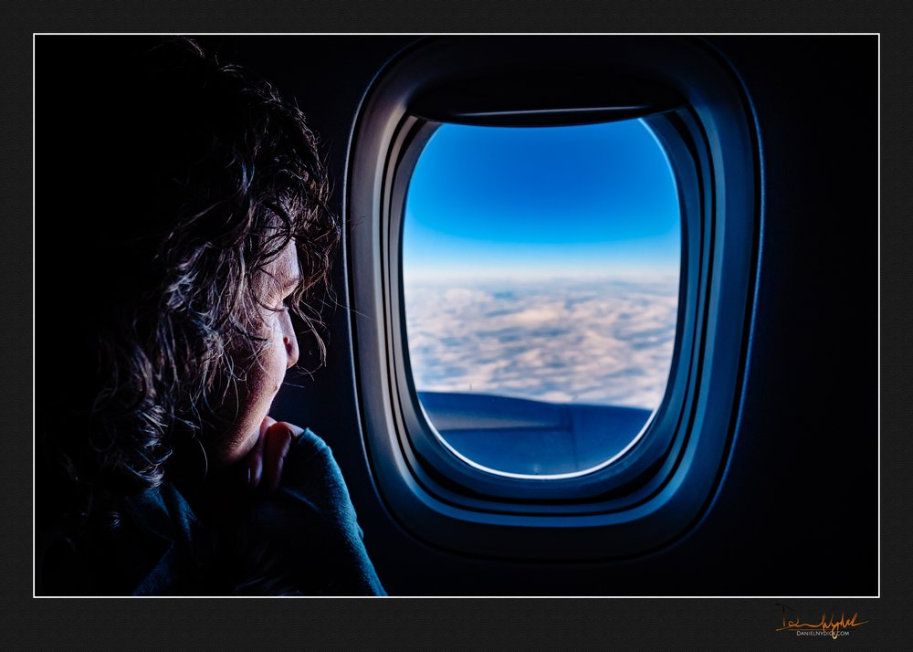 on the plane, looking out window, cluods, sky, airplane, bon voy