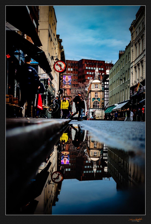 aladdin, soho, reflection, puddle, street photography