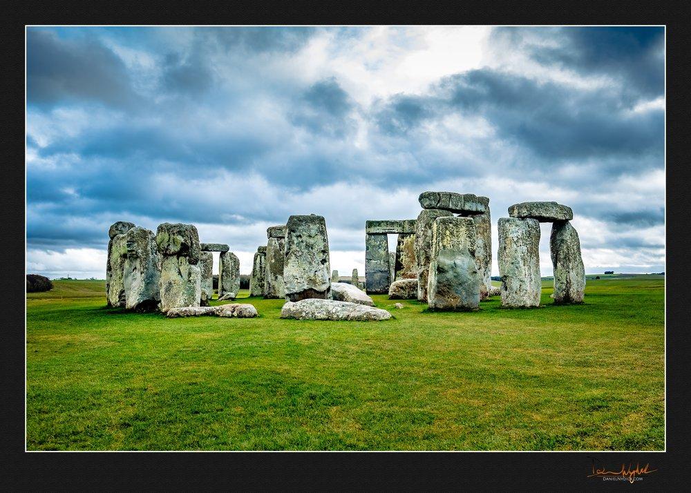 epic stonehenge, moody sky, green grass
