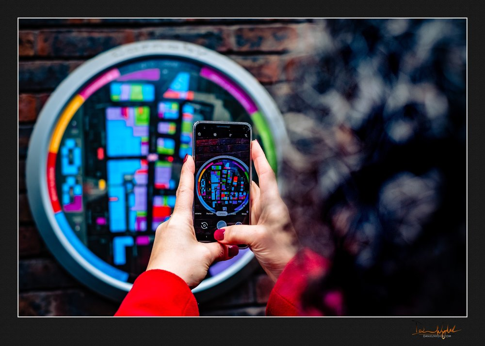 photo of someone taking a photo of a map in the carnaby shopping