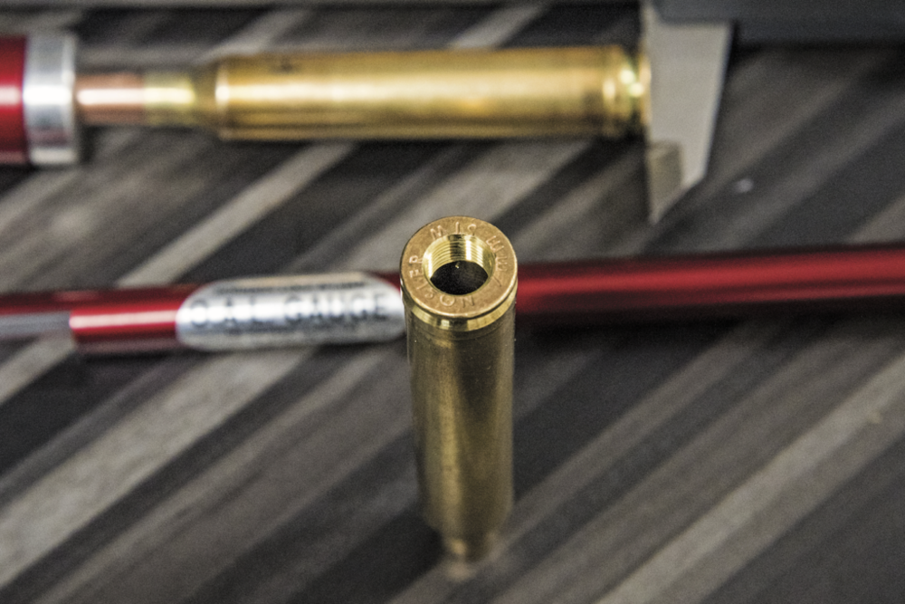 Send one of your fired cases and Hornady will thread it for their OAL gauge. It's cheaper than buying the case from them and it's custom fit to your chamber. It works better with a tight fit, too.