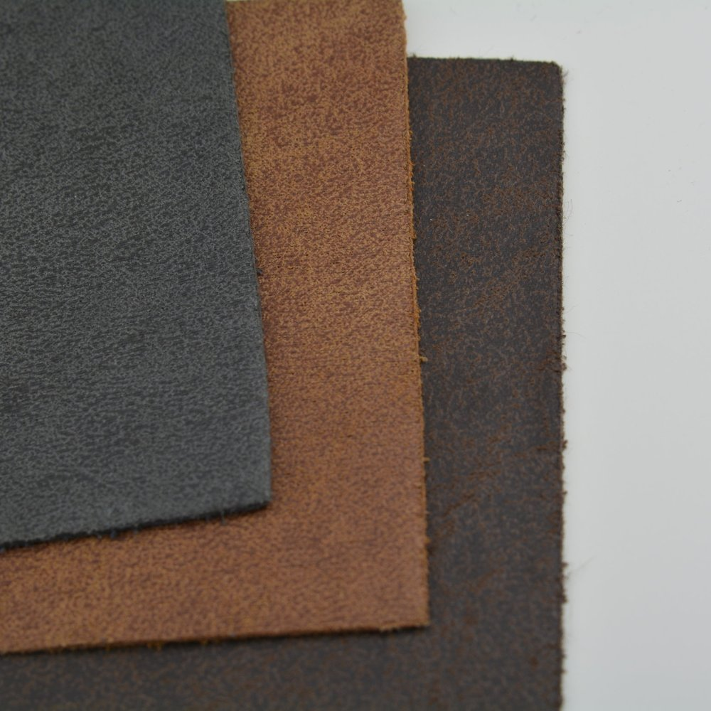 MATERIALS - Our unique recycled leather is sourced from the UK, and is sent with our designs to our manufacturer in the sunny south of Spain. The linings are 100% recycled cotton and sourced locally in Spain. We make every effort to ensure that all materials, from our leather to our packaging to our clothing, are as environmentally friendly as possible.