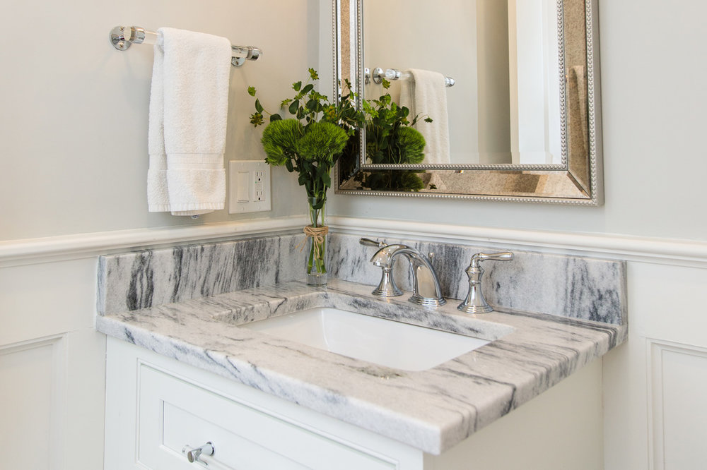 bathroom with marble countertop