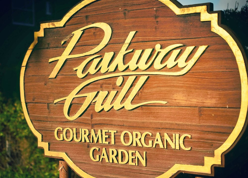 Sign for Parkway's Gourmet Organic Garden.