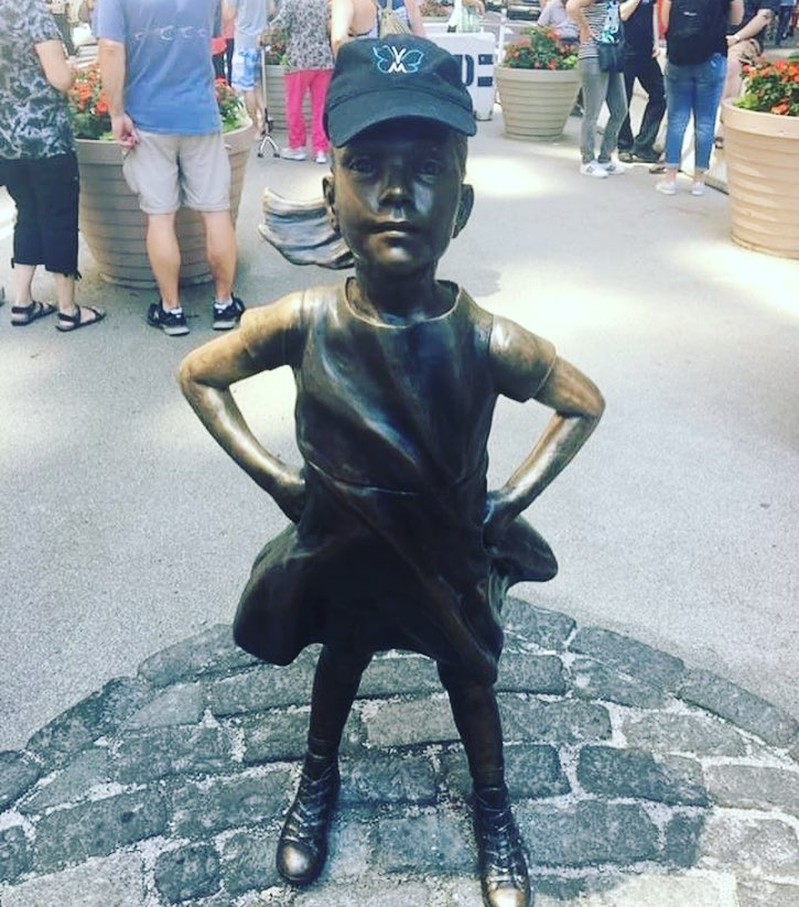 The Fearless Girl statue  in NYC wearing a VTM Foundation hat, July 2017