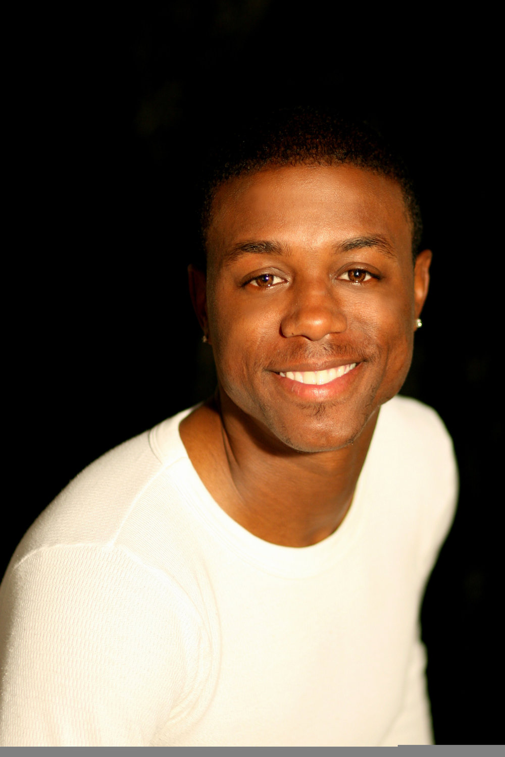 Christopher Broughton, born and raised in Los Angeles, CA, Chris began dancing at the age of 11 and has never looked back. Under the instruction of Paul and Arlene Kennedy at Universal Dance, he soon became a member of The Kennedy Tap Company where he received the national NAACP ACT-SO Award, twice. He now travels worldwide both as a soloist and with Jason Samuels Smith's A.C.G.I., Rasta Thomas'Tap Stars, and Dorrance Dance. Performances include New York City Center's Cotton Club Parade; Juba! Master's of Tap & Percussive Dance at the Kennedy Center; and Broadway's Tony & Astaire award-winning production After Midnight.Christopher owes his sincerest gratitude to his sister, Chantel Heath, who introduced him to the world of dance, Tonie Nicholas, son of the legendary Fayard Nicholas, and Paul and Arlene Kennedy; without whom, he wouldn't be where he is today.