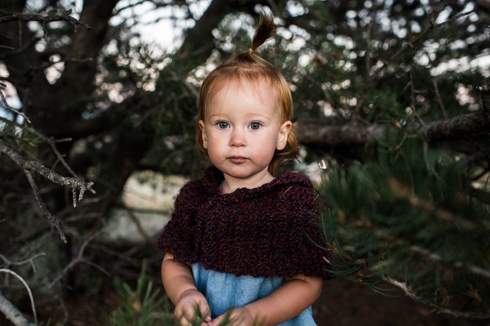 girl in pine tree in colorado mountains