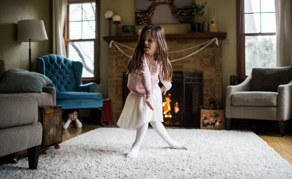 girl dances to the nutcracker at home with family