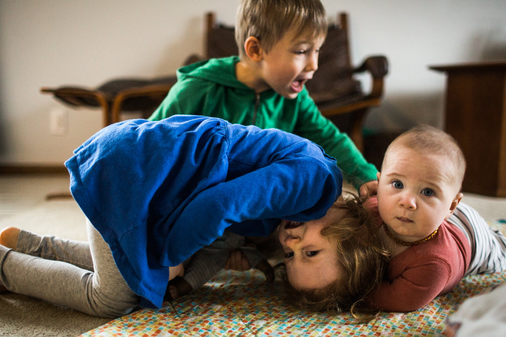kids wrestling with siblings