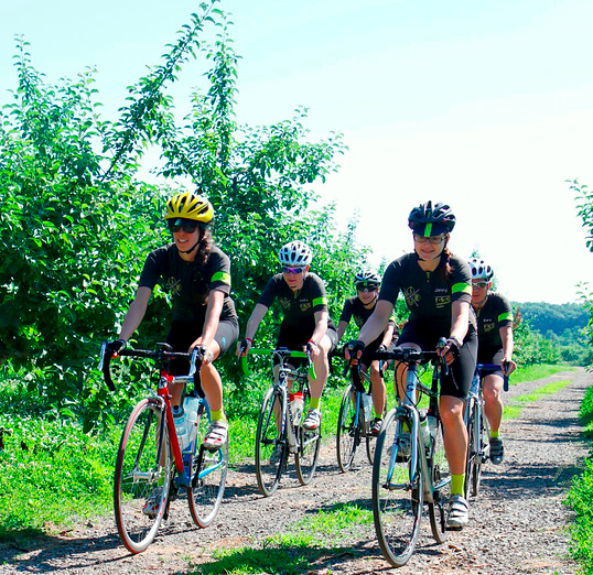 RSC Expedition Team pedals through a peaceful apple orchard in NH.