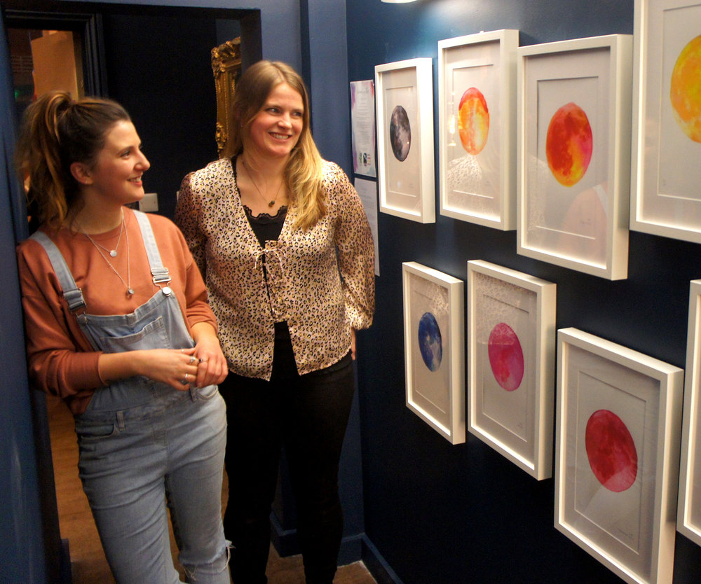 Rebecca and Maria from Drawn Together Art Collective with their colourful moon print collection