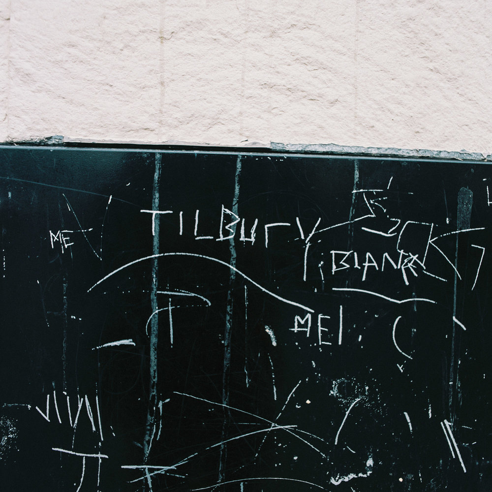 The word Tilbury is seen scratched onto the side of a building in Civic Square