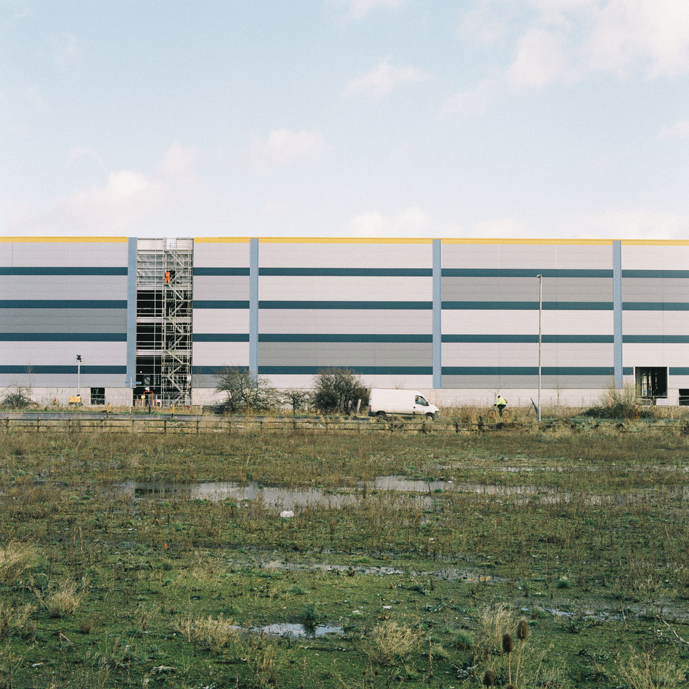 The construction of a new Amazon warehouse on the outskirts of town