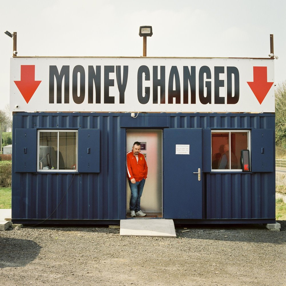 A man waits to change money a currency exchange business on the Northern Irish side of the Middletown A3 border crossing