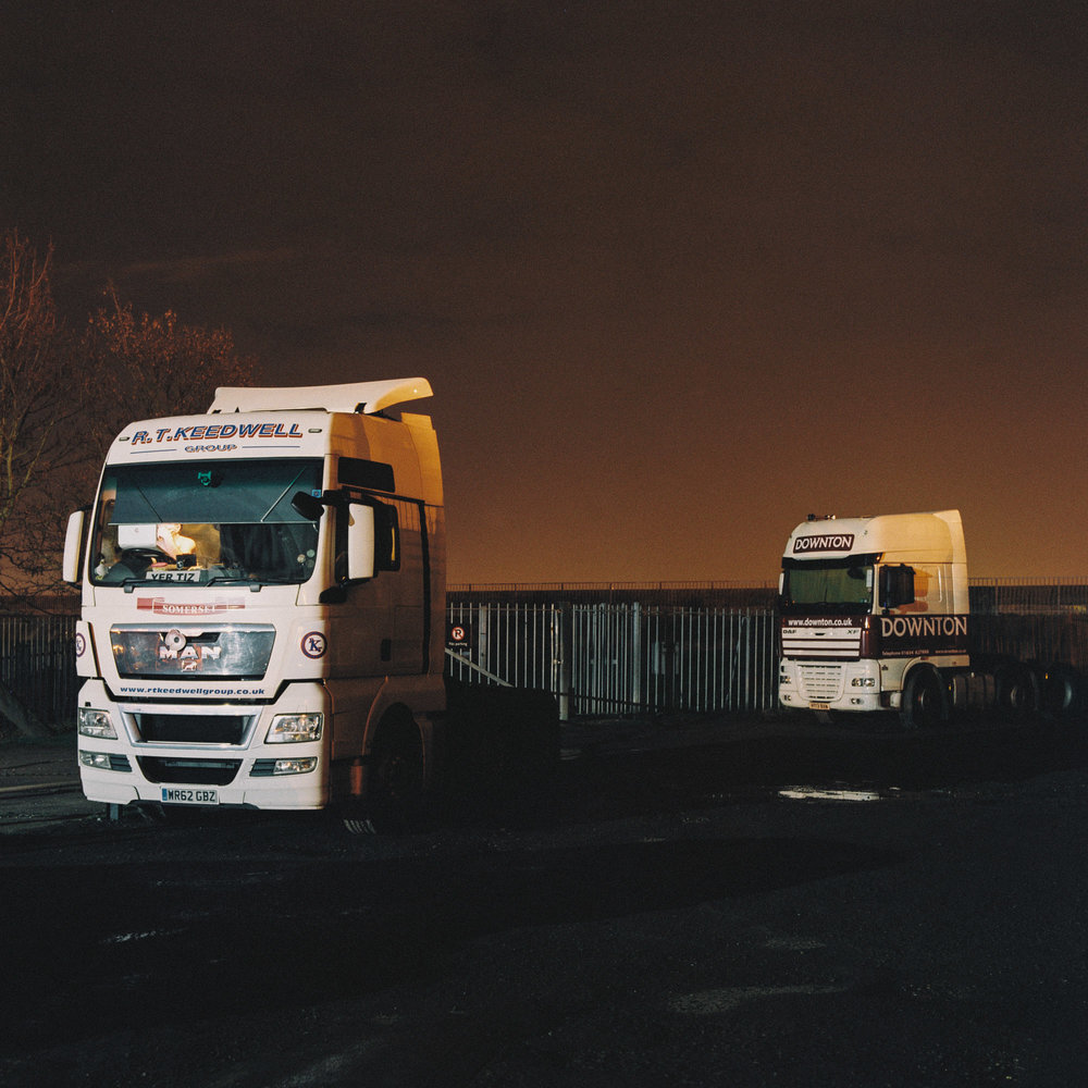 Trucks park for the night outside The World's End pub near the Port of Tilbury