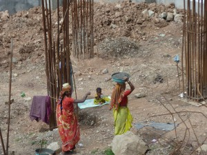 When I saw these women carrying concrete - (this is for a regular size building being constructed) I was struck by how much patience and precense they had - they carried these baskets of concrete all day long and as far as I could see never changed their pace or posture - mind boggling