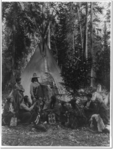 flathead-indians-holding-pre-christmas-family-gatherings-on-the-west-side-of-glacier-national-park-in-the-dense-forest-of-evergreen-trees-that-skirt-the-rocky-mountains