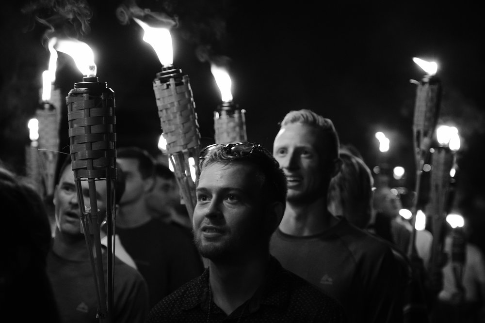 Charlottesville's troubles began on the evening of Friday, August 11th when packs of white supremacists from across the country began gathering at Nameless Field on the University of Virginia campus. Students playing volleyball in a nearby court evacuated as the marchers multiplied.  After the group grew to its ultimate size of approximately 400, they established security teams and ignited their torches. Media jostled for position and a drone buzzed overhead as the marchers reveled in their numbers.  Among the crowd were Ben Daley and Tom Gillen, members of the Rise Above Movement (RAM), a group of street-brawling white supremacists based in California.