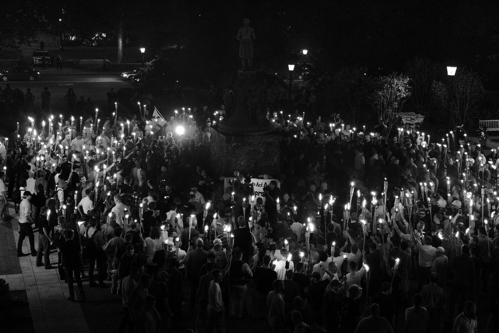 "The white supremacists marched through UVA campus until they reached the Thomas Jefferson monument where they surrounded a small group of protesters -- mostly college students -- who encircled the statue protectively. As the students chanted ""Black lives matter!"", the white supremacists attacked, beating the protesters with torches, drenching them with mace, and kicking them while they struggled to hold their ground.  Neither the Charlottesville police, nor the clergy and parishioners across the street came to the aid of the protesters who -- only having the aid of a small group of stalwart anti-fascists -- were forced to flee."