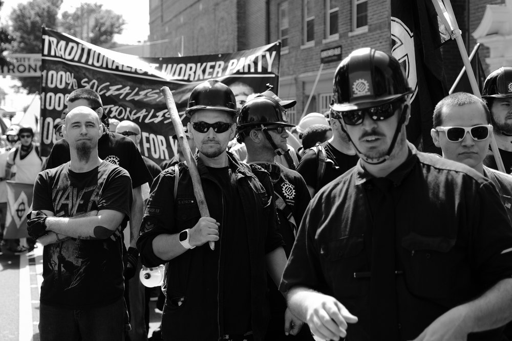 Members of the Traditionalist Worker Party arrived at Emancipation Park, ready to fight, and met a wall of protesters. They immediately charged at the protesters, initiating the first major skirmish of the day. The Traditionalist Worker Party is a neo-Nazi organization that recruits primarily from the working class in the midwest.
