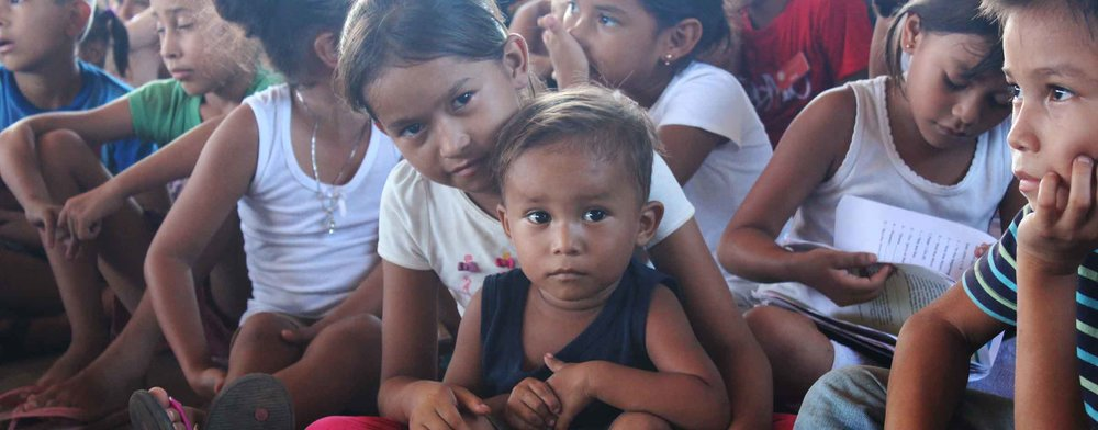 Little kids in Nicaragua gathering together during a mission trip