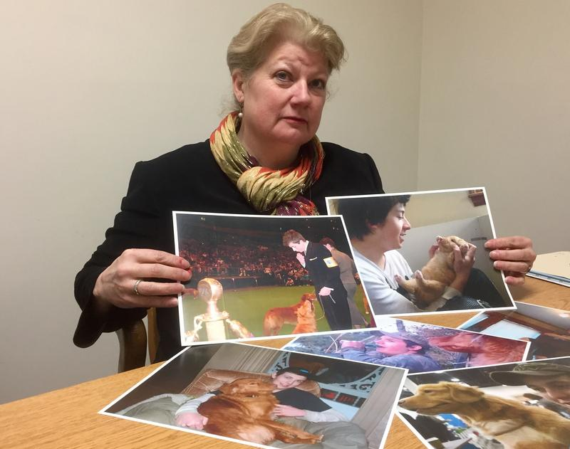 Judy Tilton holds up photos of her son Seth Tilton-Fogg, 21, who died in 2015 after injecting heroin laced fentanyl dealt by Brian Watson, 52, of Northfield. Paige Sutherland, NHPR
