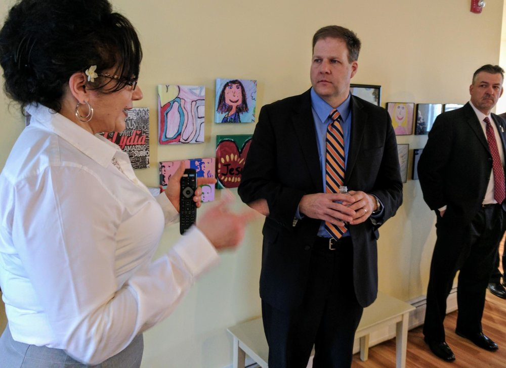 Sununu speaks with Theresa Tozier who runs Lydia's House of Hope in Somerworth. Credit Jason Moon for NHPR